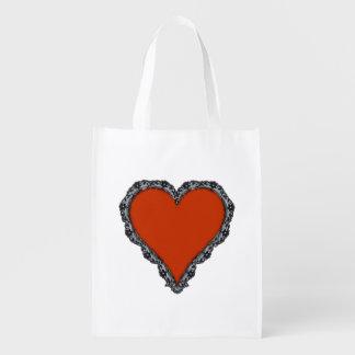 Corazón rojo oscuro rodeado por diseño negro del bolsas para la compra