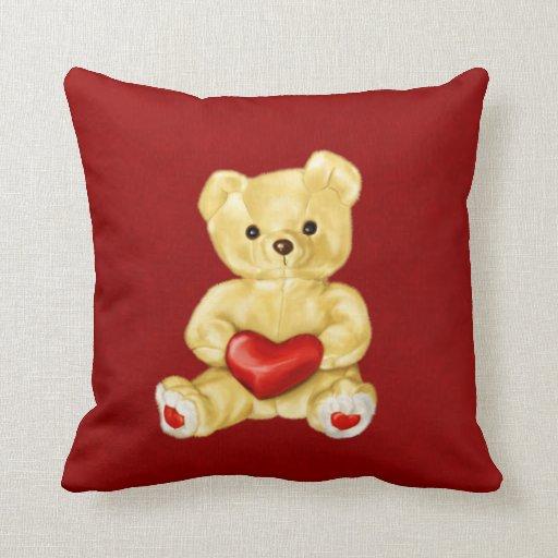 Corazón rojo que hipnotiza el oso de peluche lindo cojín