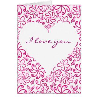 Corazón rosado con la tarjeta de felicitación de l