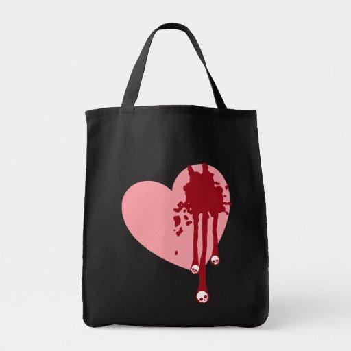 Corazón rosado con los goteos del cráneo bolsa tela para la compra