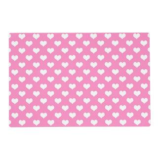 Corazón rosado del lunar del fondo de los tapete individual