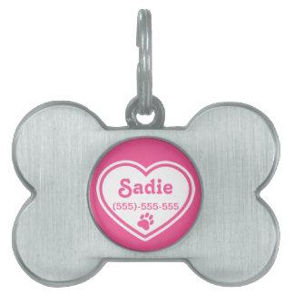 Corazón rosado y blanco con una impresión de la pa placas de mascota