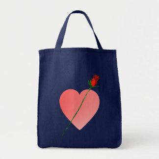 Corazón rosado y bolso color de rosa bolsas