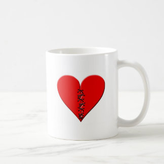 Corazón roto, parchado taza de café