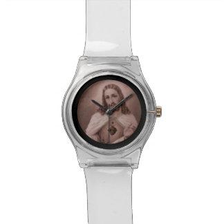 Corazón sagrado con la cruz reloj