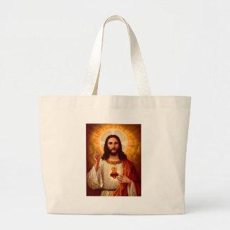 Corazón sagrado religioso hermoso de la imagen de  bolsas