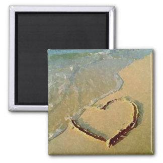 Corazón salado en imán de la arena