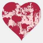 Corazón sangrante pegatina en forma de corazón