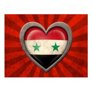 Corazón sirio envejecido de la bandera con los ray tarjeta postal