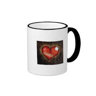 Corazón-taza del corazón quebrado de la reparación