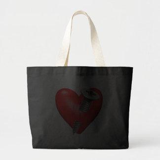 Corazón y tornillo rojos bolsas