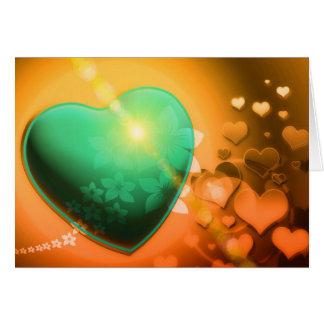 Corazón y trébol verdes anaranjados del fondo w de tarjeta pequeña