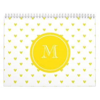 Corazones amarillos del brillo con el monograma calendario