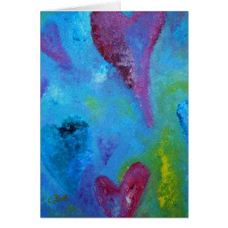 Corazones con la tarjeta del arte del amor