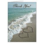 Corazones de la arena en la playa, gracias las tar felicitación
