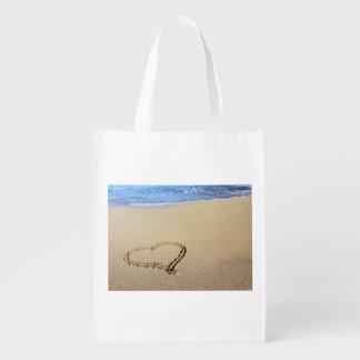 Corazones de la playa en arena bolsa de la compra