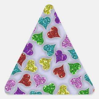 Corazones de los brillos en el fondo blanco pegatina triangular