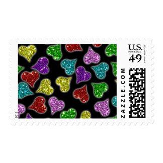Corazones de los brillos en fondo negro timbre postal