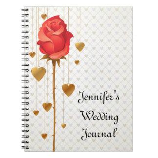 Corazones de oro del amor y diario color de rosa d libreta