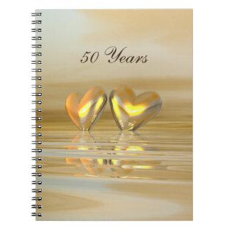 Corazones de oro del aniversario cuaderno