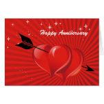 Corazones del amor con la tarjeta del aniversario