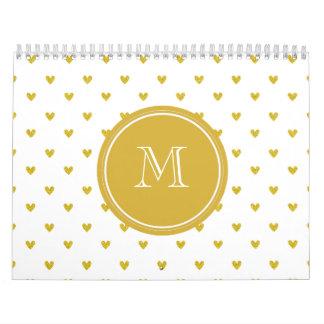 Corazones del brillo del oro con el monograma calendarios de pared