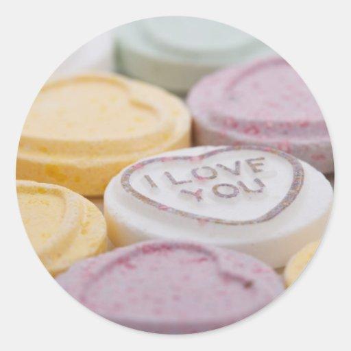 Corazones del caramelo de la tarjeta del día de pegatina redonda