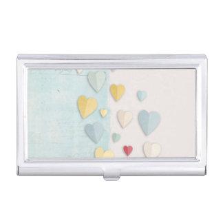 Corazones doblados fondo blanco azul caja de tarjetas de negocios