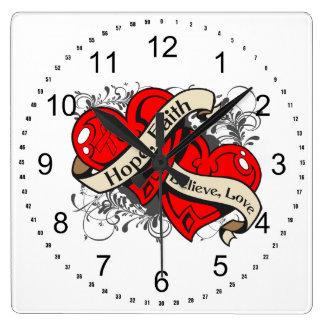 Corazones duales de la fe de la esperanza de la en reloj de pared