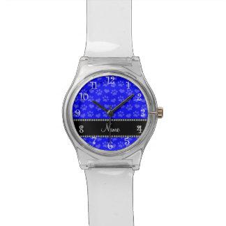 Corazones e impresiones azules de neón conocidos relojes de mano
