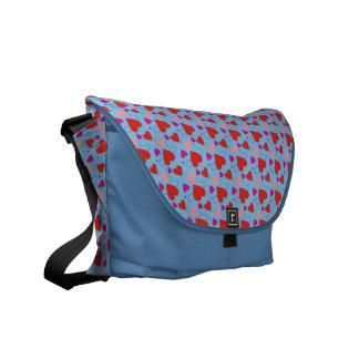 Corazones en un fondo azul bolsas de mensajería