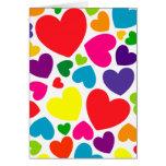 Corazones femeninos coloridos brillantes tarjeta