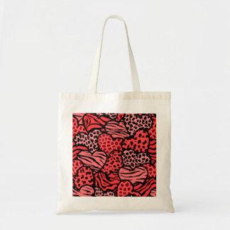Corazones femeninos rojos y negros del estampado bolsa de mano