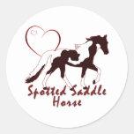 Corazones manchados del caballo de silla de montar etiquetas redondas