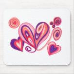 Corazones púrpuras rosados del amor tapete de raton