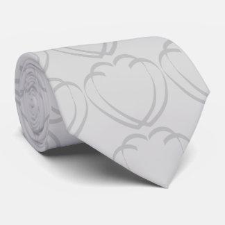 Corazones que entrelazan que casan la corbata