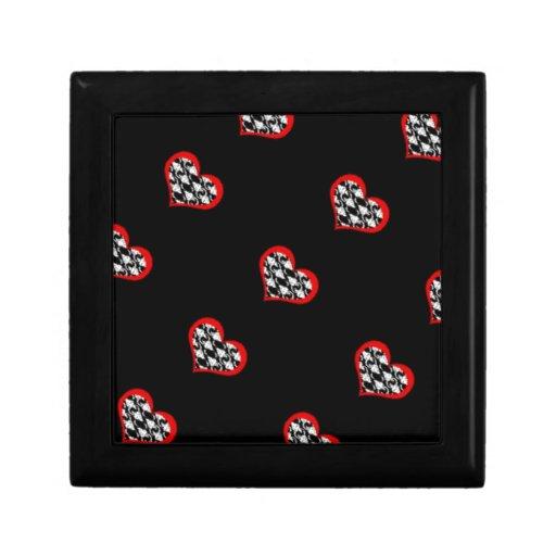 Corazones rojos en fondo negro caja de regalo