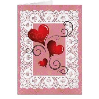Corazones rojos y tarjeta blanca 2 de la tarjeta