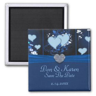 Corazones románticos en fecha floral azul de la re imán de frigorífico