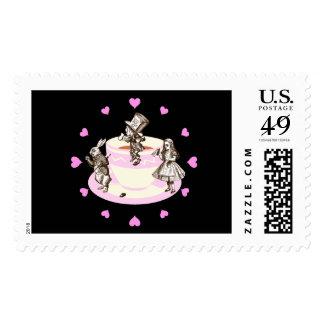 Corazones rosados alrededor de una fiesta del té timbre postal