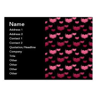 Corazones rosados del vuelo en negro tarjetas de negocios