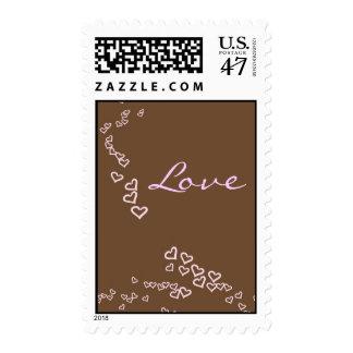 Corazones rosados y marrones timbre postal