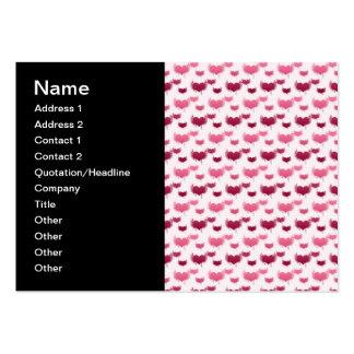 Corazones rosados y rojos del vuelo tarjeta de visita