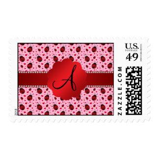 Corazones rosas claros de las mariquitas del timbre postal