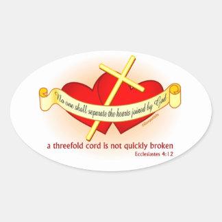Corazones unidos por el regalo del cristiano de calcomanía oval