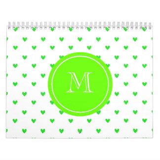 Corazones verdes claros del brillo con el calendario de pared