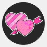 corazones y flecha del grunge etiquetas redondas