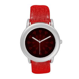 Corazones y flechas rojos reloj