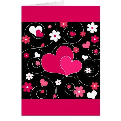 Corazones y flores tarjeta