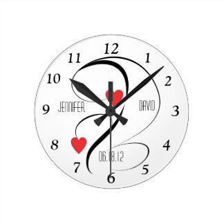 Corazones y remolinos modernos que casan el reloj